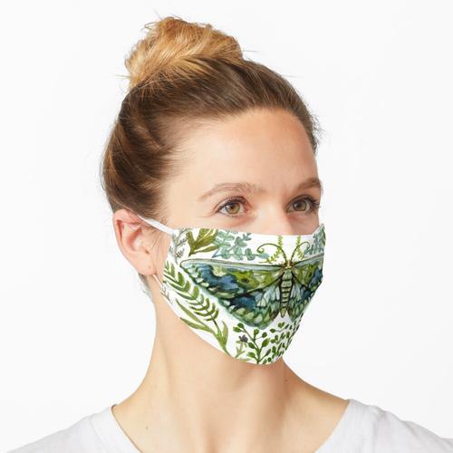 Motte mit Pflanzen Maske
